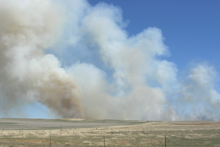 Uncontrolled prairie fire driven by SE winds
