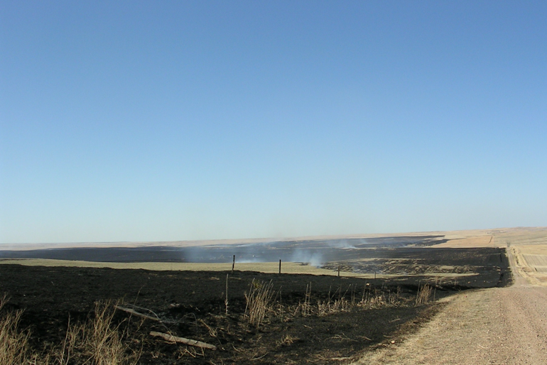 Prairie fire blackened a large area Tuesday.